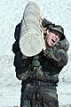 US Navy 071217-N-3398B-274 Olympic hopeful Stacy Dragila strains to lift a log above her head during a log physical training evolution at the Naval Special Warfare Center.jpg