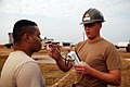 US Navy 080919-N-0193M-003 Hospital Corpsman 1st Class John Southwell checks the temperature of Pfc. Juan Sifuentes.jpg