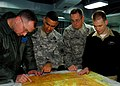 US Navy 090130-N-4044H-042 Service members from various branches of the U.S. military embarked aboard the amphibious command ship USS Mount Whitney (LCC 20) review a tactical pilot chart during the planning phase of Austere Cha.jpg