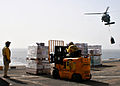 US Navy 090214-N-6764G-058 Sailors move pallets of supplies delivered by an MH-60S Sea Hawk.jpg