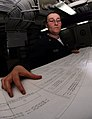 US Navy 090318-N-9928E-015 Storekeeper 2nd Class Jessica Reese reviews ventilation drawings in the maintenance support center aboard USS John C. Stennis (CVN 74).jpg