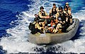 US Navy 090524-N-4774B-063 Members of the visit, board, search, and seizure team transport Somali migrant children to the guided-missile cruiser USS Lake Champlain (CG 57) after being rescued from a disabled skiff.jpg