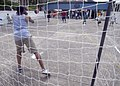 US Navy 090528-N-4879G-139 Hospital Corpsman 3rd Class Terence Ash, assigned to the guided-missile frigate USS Doyle (FFG 39), attempts to block a shot from a Guatemalan boy during a community service project at a local orphan.jpg