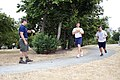 US Navy 090804-N-5366K-094 Chief Special Warfare Operator (SEAL) Jason Torey keeps time as KNDD radio station host Andrew Harms, right, runs 1.5 miles to practice for the Navy SEAL Fitness Challenge at Surrey Downs Park.jpg