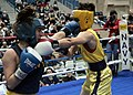 US Navy 100226-N-3066M-003 Midshipman 2nd Class Robyn Wegele, left, and Midshipman 3rd Class Miriam Feild compete in the 69th annual U.S. Naval Academy Brigade Boxing Championships.jpg