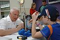 US Navy 100316-N-4716P-029 Master Chief Machinist Mate Randy Huckaba, chief of the boat of the guided-missile submarine USS Florida (SSGN 728), plays Battleship with a patient at the St. Joseph's Children's Hospital.jpg