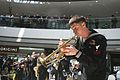 US Navy 100328-N-9719D-461 Musician 2nd Class Collin Reichow plays the trumpet during a performance t the International Finance Centre of Hong Kong.jpg