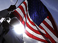 US Navy 100415-N-7586L-257 Culinary Specialist 1st Class Arnel Ortega, assigned to Joint Base Pearl Harbor-Hickam raises the National Ensign.jpg