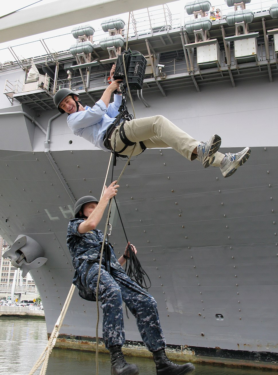 US Navy 100527-N-0000B-016 Office of Naval Research (ONR) Command Master Chief Charles Ziervogel, bottom, and Fox News reporter Peter Doocy demonstrate the capabilities the ONR funded Atlas Power Ascender during Fleet Week New