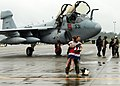 US Navy 100606-N-9860Y-002 Cmdr. Chris Bergen, from Jefferson Township, N.J. executive officer of the Wizards of Electronic Attack Squadron (VAQ) 133, is greeted by his daughter.jpg
