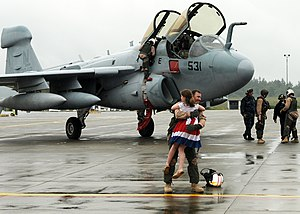 US Navy 100606-N-9860Y-002 Cmdr. Chris Bergen, from Jefferson Township, N.J. executive officer of the Wizards of Electronic Attack Squadron (VAQ) 133, is greeted by his daughter