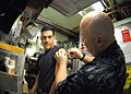 US Navy 101013-N-7705S-031 Chief Hospital Corpsman Dale Lyons administers the annual influenza vaccination to Electronics Technician Seaman Thomas.jpg