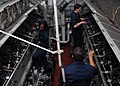 US Navy 110302-N-DM338-102 Sailors open the cylinder head covers on the aft emergency diesel generators in preparation for daily maintenance.jpg