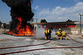 US Navy 110701-N-NR955-176 A firefighting team puts out a fire during a disaster training exercise at the Portuguese School of Naval Technologies t.jpg
