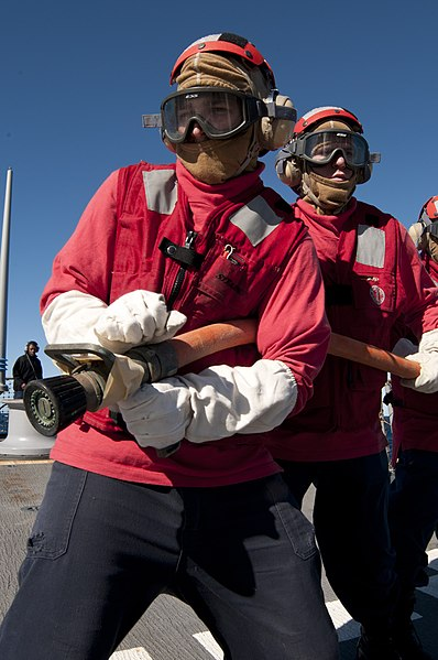 File:US Navy 110711-N-EA192-101 Damage Controlman 3rd Class Jack Morris mans a hose during a crash and smash drill aboard USS Fitzgerald (DDG 62).jpg
