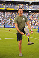 US Navy 110811-N-DM186-076 A Navy Hospital Corpsman from Wounded Warriors Battalion West shows his prosthetic leg during a halftime presentation at.jpg
