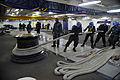 US Navy 111216-N-VE701-015 Sailors aboard the Nimitz-class aircraft carrier USS Harry S. Truman (CVN 75) secure a line to the capstan while hoistin.jpg