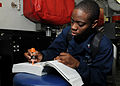 US Navy 120204-N-TU894-044 Aviation Ordnanceman 3rd Class Angela M. Roberts studies for an advancement exam aboard the aircraft carrier USS George.jpg