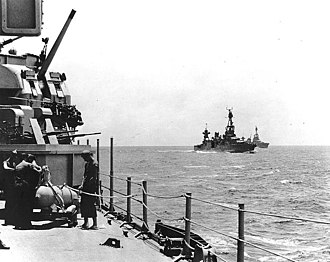 Battle of Rennell Island - U.S. cruisers of Task Force 18 at sea en route to Guadalcanal on 29 January 1943, just hours prior to the Japanese night air attack off Rennell Island. Photographed from USS Wichita. USS Chicago is in the right center, with Louisville in the distance.