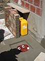 Urine canister in front of the UDDT (8101765112).jpg