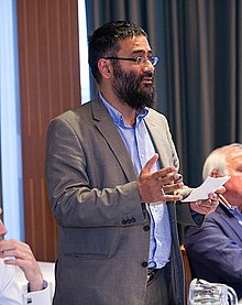 Usama Hasan speaking at Army and Navy Club, Saint James, London.jpg