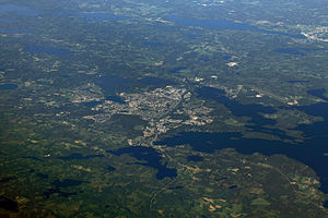 Växjö - Växjö surrounded by lakes as seen from an aeroplane moving between Norway and Poland. West is up in the image.
