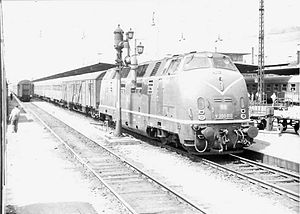 Deutsche Bundesbahn - V200 number 010 pulling passenger train in West Germany, c. 1961.