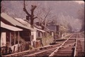 VIEW OF MINERS' HOMES IN A COAL COMPANY TOWN NEAR LOGAN WEST VIRGINIA. NEXT TO THE RAILROAD TRACKS. THEY ARE ACROSS... - NARA - 556434.tif