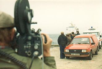 Scotland Today - News Cameraman Varick Easton on Tiree filming arrival of the Oban ferry (October 1985)