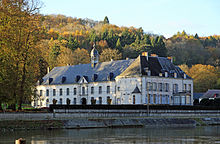 The former abbey seen from the Meuse river Waulsort Abbaye R01.jpg