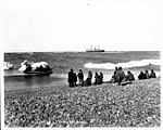 Yupik people on beach at Whalen, Siberia, with Steamship CORWIN in distance, 1907 (NOWELL 185).jpeg