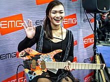 Yvette Young at EMG booth NAMM 21st January 2016.jpg