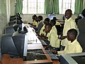 Zambian kids learning how to use computers.jpg