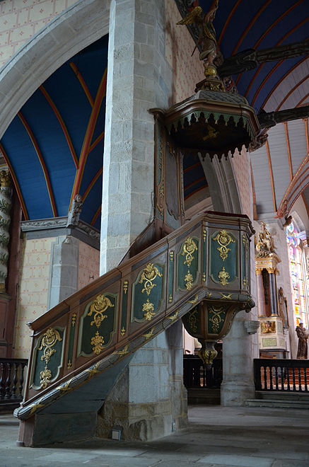 "The pulpit in the church of St Suliau. This pulpit (""chaire à prêcher"") dates to 1784 and is the work of Yves Cevaer."