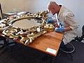 06 Restoration of gilded mirror in Muzeum Gornoslaskie, Bytom, Poland - furniture restorer working.jpg
