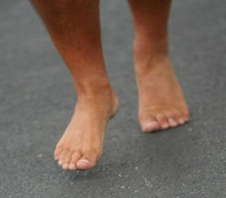 Pronation of the foot - Closeup of a person running barefoot