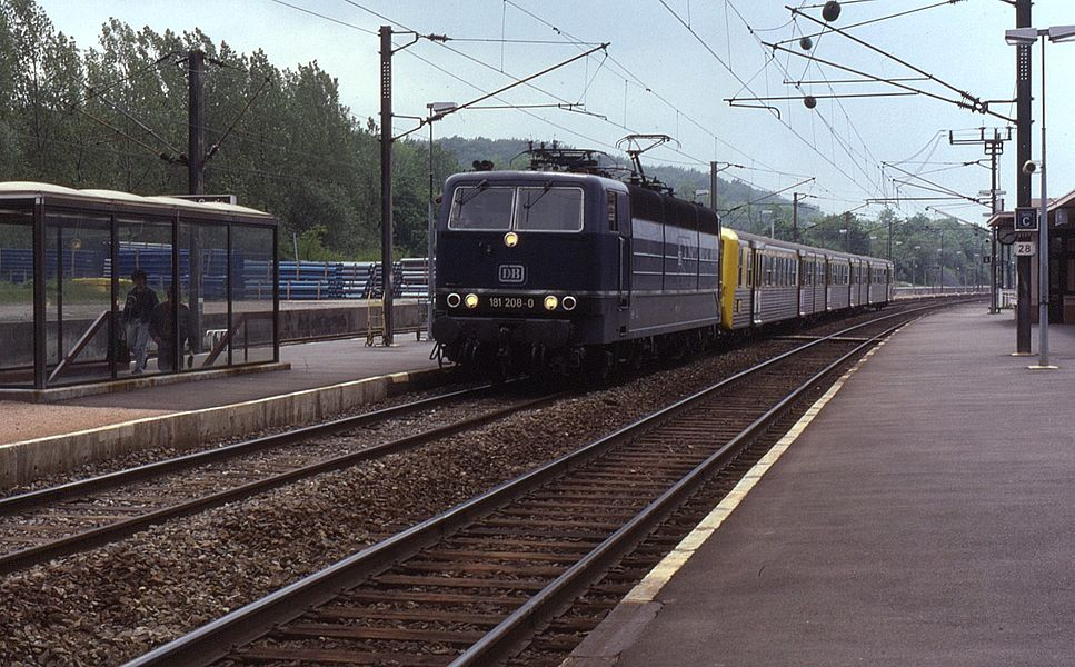 "Seen hauling a rake of TER ""RRR"" stock on a Saarbrücken to Metz service on 8 June 1991. This section of line saw these DB multi-voltage locos working passenger and freight trains. Note right hand running, this being operating practice in certain areas of eastern France."