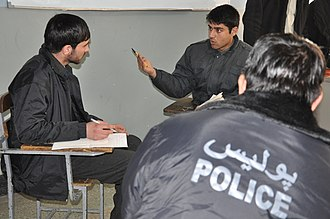Management of domestic violence - Afghan National Police instructors conduct a role playing scenario dealing with sexual abuse at the Afghan National Police Academy, Kabul, Afghanistan on December 30, 2010. Dr. Anna Baldry taught the Train the Trainer Gender Seminar to give ANP instructors more comprehensive and effective delivery methods for the current curriculum on domestic violence and sexual abuse. (U.S. Navy photo by Chief Petty Officer Brian Brannon/Released)