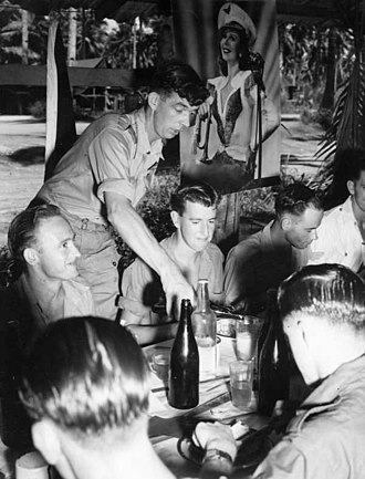 No. 11 Group RAAF - The commanding officer of No. 11 Group serving a drink to an airman at the group headquarters' Christmas dinner