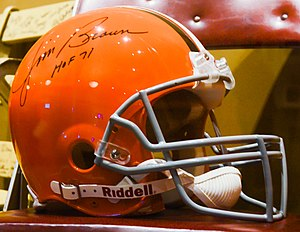 Jim Brown - A helmet signed by Brown in exhibition
