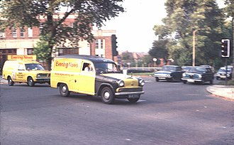 The Evening News (London newspaper) - Two Evening News delivery vans cross the North Circular Road in Finchley, September 1975