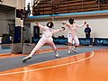 2nd Leonidas Pirgos Fencing Tournament. Evrikidi Koletsou performs a lunge and scores a touch.jpg