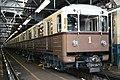 81-717.5A-714.5A retro train in depot.jpg