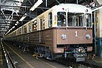 81-717.5A-714.5A retro train in depot.jpg