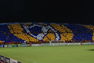APOEL FC - The club's colours and badge displayed by APOEL fans in the 2009–10 Champions League match against Chelsea.