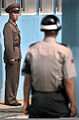 A North Korean Guard glares at a ROK Army Guard as they positioned themselves on either side of the Military Demarcation Line (MDL) prior to a repatriation ceremony at the Panmunjom Freedom House for what is 981009-F-FC975-507.jpg