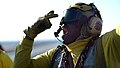 A Sailor directs fire fighting training at sea..jpg