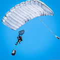 A U.S. Air Force pararescueman with the 131st Rescue Squadron trains on high-altitude, low-opening parachute techniques above Moffett Federal Airfield, Calif., June 2, 2013 130602-Z-HW473-193.jpg