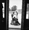 A nurse with a patient at Sandleford Priory, a country house at Sandleford in Berkshire, one of many taken over by the Joint War Organisation (of the British Red Cross and Order of St John) to provide convalesc H10497.jpg
