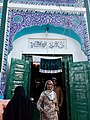 A woman coming out of Shrine of Hazrat Ghous Muhammad Bala Pir, Okara.jpg